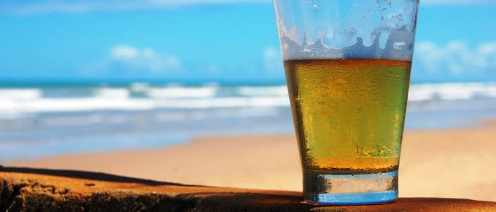 beer at the beach in costa rica