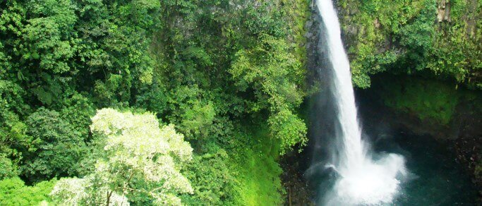 zip lining tour over waterfalls from la fortuna